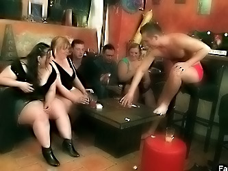 BBW bitches sucking on cock in bar