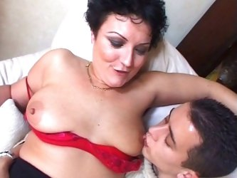 Horny big tits granny enjoying young white and black boners