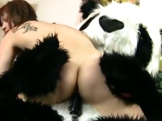 Sexy chick fucks with funny panda