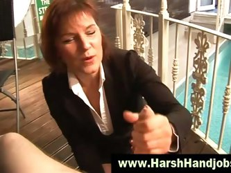 Angry mature gives harsh handjob
