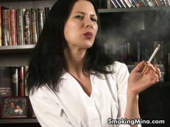 Some mature lady smokes and shows tits