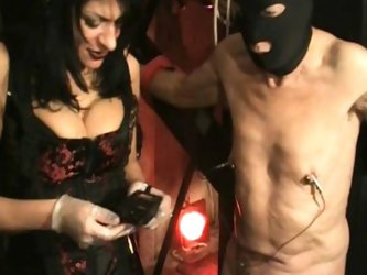 Beautiful mistress with big tits pulls meat hook through nipples of naughty slave and spanks him on his ass