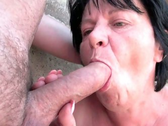 Busty grandmother plays with cock outdoors
