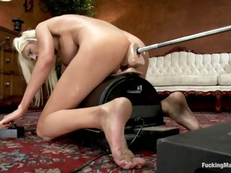 Busty blonde Puma Swede takes a ride on a fucking machine