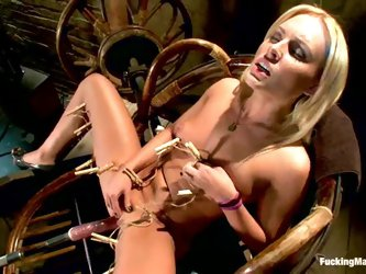 Sexy blonde babe Jamey Janes gets satisfied by a fucking machine
