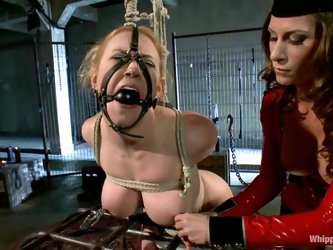Busty blond gets tied up and staffed with toys