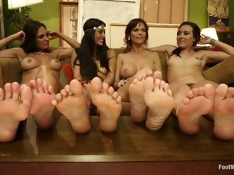 Four babes show their sexy feet and lick pussies