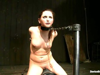 Long-haired girl gets chained and toyed with a machine