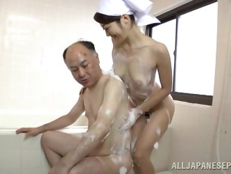Busty hottie nurse Maki Hokujo enjoys an older man cock.