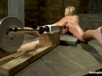 Tied up girl gets her wet pussy drilled by a fucking machine