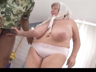 Slutty BBW granny is fucked by a black monster cock