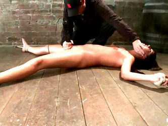 Bound Cassandra Nix gets her shaved pussy toyed