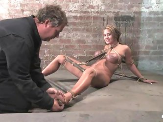 Busty Trina Michaels gives a handjob and gets dominated