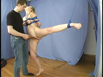 Blonde Leila gets suspended and whipped in BDSM video