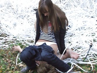 Perverted lady bounds her slave near the tree and uses him as an ashtray