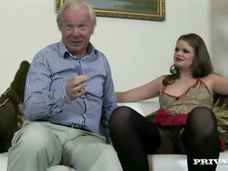 Whitehaired daddy stimulates her shaved pussy with a dildo in order to arouse this young whore. By getting horny enough, she gives him a nice blowjob