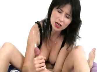 Take a look at this amazing POV where a kinky mom jerks this guy's big cock until he unloads his semen on her face.
