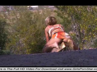 At the edge of a road a very sexy blonde masturbating passionately in nature