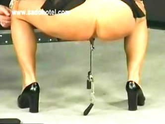 Big titted slave got metal clamps on her boobs and her tight pussy with heavy weights