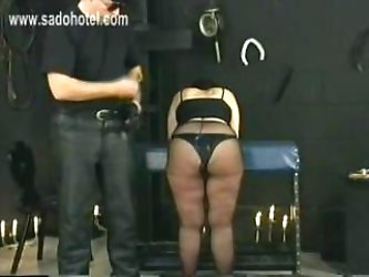 German master shouts and hits scared slave with big tits in his dungeon on her fat ass