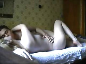 Homemade video with a blonde Russian chick waking up her boyfriend, sucking his dick and fucking him.