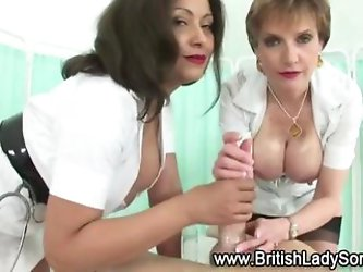 British mature sluts Lady Sonia and friend lather up cock and oil up tits for naughty nurse fantasy