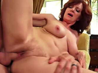 Passionate, red haired mature woman, Andi james likes to fuck her tattooed lover, every day
