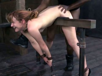 Young whore Claire Robbins is tied and bent over the bar and two guys serve her from two sides. One guy fucks her in the mouth while the other guy ban
