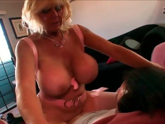 This sex-starved bitch with huge juicy melons has a never ending sex drive. She climbs on top of this young stud's cock and rides him passionatel