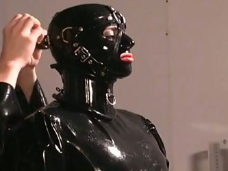 Stunning light-haired slut in latex costume bends over to get her juicy booty slapped by raven-haired mistress. Then brunette punisher chains her slav