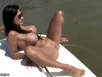 Brunette bombshell Aletta Ocean is waiting for you in this action! Stare at how she is staying topless on a yacht and starting to sunbathe showing her