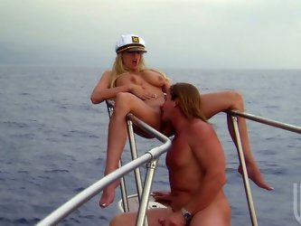 Sexy blonde milf Stormy Daniels blows dick on the yacht. The horny captain also eats her before banging her naughty cunt.