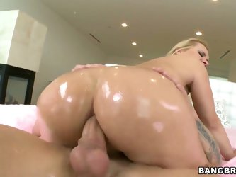 Arousing blonde milf Katja Kassin with big tits and heavy make up gets her huge round ass oiled and boned deep all over the living room by her horny l