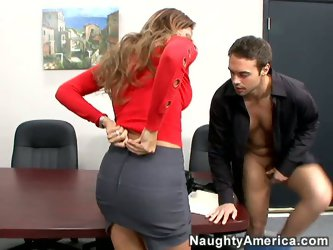 Monique Fuentes is an office slut. The chestnut bitch is dressed in short skirt and sexy red shirt. The whore gives him hot blowjob.
