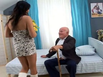 Naughty brunette bitch with chubby body and small tits is here to please old horny man. She takes off her clothes in front of him. Then she gives him