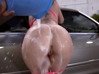 Car needs to be washed so stunning cougar comes outdoors to wash it in very seductive way. Woman teases huge boobs for cameraman and even allows guy t