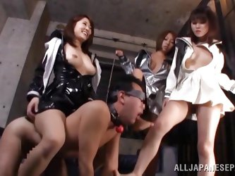 Their male sex slave is gaged and on all fours. He has to endure their domination and do, what ever they tell him to do. Watch, as they step on him an