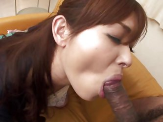 Hitomi is on the couch with her legs spread and a lot of lust for some cock. I give her a sex toy and she begins fucking herself in the ass with it, a