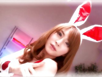 This lovely looking lady is super sexy in her bunny outfit. She climbs on top of her man and kisses him sensually. Watch, as the Japanese beauty sucks