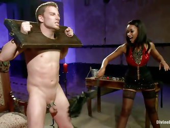 Queen Skin Diamond bound Sebastian Keys with fetters. The ebony goddess whips his tiny cock until its raw and red. She makes him beg for more and sque