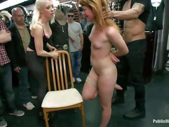 Slutty redhead Claire enjoys being humiliated in public. She sits on her knees with a vibrator on her cunt and is waiting for more commands from the p