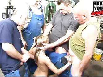 Teen young blonde bitch with small tits is gagged by a group of four pussy hungry strangers. She used to work in this warehouse where she is grabbed b