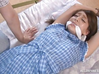 This man ties his girlfriend with rope. Her ankles and wrists are bound so she can not escape while he has his way with her. He bends her over and spr