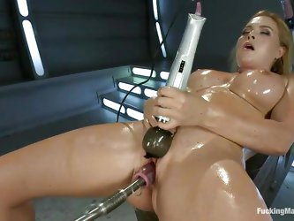 Enjoy watching this sexy blonde milf with oiled boobs and a juicy pink vagina. She is having a lot fun alone, fucking her cunt with a dildo attached o