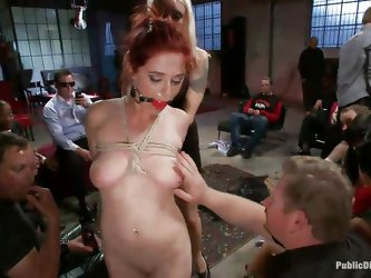 Redhead Penny is walked around and everybody touches, and smells her. Being treated like a sex slave, makes Penny really horny and blonde Lorelei brin