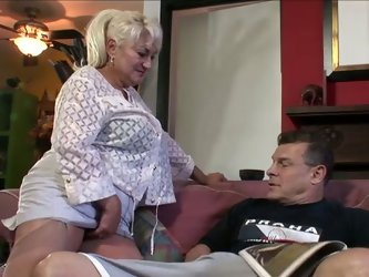 This sex-starved granny is a head turner! Those big boobs can send you into a trance. Cock crazed slut has no clue about how to handle her hubby'