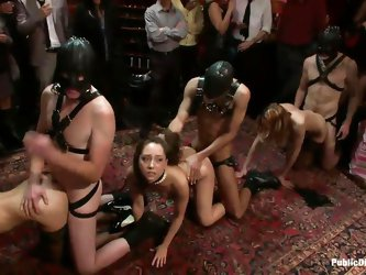 Watch Remy Lacroix and her friends standing on their knees, anxious about the masked guys and their big cocks sitting in front of them. They start to