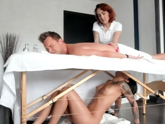 Horny masseuse gets under the table and sucks client till assistant leaves the room. Then black manual therapist comes out and lies on the table to be