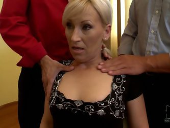 Playing poker over the table she goes nuts. She lets those horny studs touch her boobs so they knead them actively. Kinky blond mom enjoys the evening