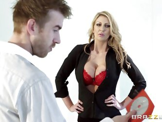 How can these guys work when they are distracted by Leigh's cleavage! Look at her, this blonde does it on purpose, showing her big boobs and mess